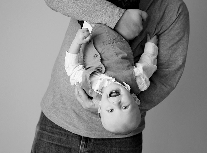 Candid playful 1 yr baby portrait with dad taken by MN photographer Kari Layland.